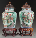 Asian:Chinese, A PAIR OF LIDDED CHINESE FAMILLE VERTE PORCELAIN JARS WITH WOODBASES. 12 inches high (30.5 cm) (vase). ... (Total: 2 Items)