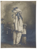 Photography:Official Photos, STUNNING PLATINUM PRINT OF SIOUX WAR CHIEF. Exquisite platinum image of an unknown Sioux war chief in feathered headdress an... (Total: 1 Item)