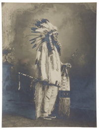 STUNNING PLATINUM PRINT OF SIOUX WAR CHIEF. Exquisite platinum image of an unknown Sioux war chief in feathered headdres...