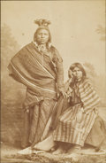 "Photography:Studio Portraits, ATTRACTIVE STUDIO IMAGE OF UTE INDIAN COUPLE.Identified only as ""Ute Indians"" this handsome couple poses for a studio im... (Total: 1 Item)"