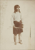 Photography:Official Photos, HAND-TINTED IMAGE OF UNIDENTIFIED INDIAN IN PERIOD FRAME. Anunnamed Indian stands holding his bow and arrows, with a blanke...(Total: 1 Item)