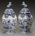 Decorative Arts, Continental:Other , A PAIR OF DUTCH DELFT LIDDED JARS, 20th century. Marks: LF.14 inches high (35.6 cm) . ... (Total: 2 Items)