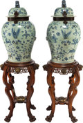 Asian:Chinese, A PAIR OF CHINESE BLUE AND WHITE PORCELAIN GINGER JARS WITH IRONMOUNTS ON MAHOGANY AND BRASS STANDS. 55 inches high (139.7 ...(Total: 4 Items)