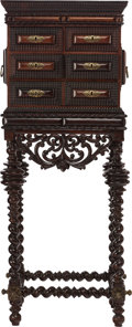 Furniture : Continental, A PORTUGUESE CARVED CABINET ON STAND, 18th century. 50-1/2 x 19-1/4x 12-1/2 inches (128.3 x 48.9 x 31.8 cm). ...