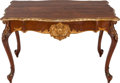 Furniture : Continental, A GERMAN ROCOCO-STYLE WALNUT AND PARCEL GILT TABLE, circa 1900. 30x 47-1/2 x 32 inches (76.2 x 120.7 x 81.3 cm). ...