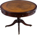 Furniture , A REGENCY MAHOGANY AND LEATHER DRUM TABLE, early 19th century. 30-1/2 inches high x 44 inches diameter (77.5 x 111.8 cm). ...