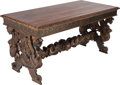 Furniture : Continental, A SPANISH RENAISSANCE-STYLE CARVED WALNUT, POLYCHROME AND PARCEL GILT TRESTLE TABLE, circa 1880. 30 x 60 x 30-1/2 inches (76...