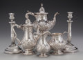 Silver & Vertu:Hollowware, A SIX PIECE ASSEMBLED ENGLISH SILVER TEA AND COFFEE SERVICE WITH CANDLESTICKS, circa 1864. Marks to coffee pot: (lion passan... (Total: 6 Items)