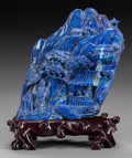 Asian:Chinese, A CHINESE LAPIS LAZULI MOUNTAIN ON A ROSEWOOD STAND. 10-1/4 x 8 x 5inches (26.0 x 20.3 x 12.7 cm) (including stand). From...