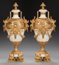 Decorative Arts, Continental:Other , A PAIR OF LOUIS XVI-STYLE WHITE MARBLE URNS WITH GILT BRONZEMOUNTS, early-20th century. 28 x 13 x 9 inches (71.1 x 33.0 x 2...(Total: 2 Items)