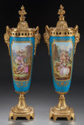 Ceramics & Porcelain, A PAIR OF SEVRES-STYLE PORCELAIN URNS WITH GILT BRONZE MOUNTS, circa 1900. Signed: Morin. 19-1/2 inches high (49.5 cm). ... (Total: 2 Items)