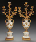 Decorative Arts, Continental:Lamps & Lighting, A PAIR OF LOUIS XVI-STYLE GILT BRONZE AND MARBLE THREE-LIGHTCANDELABRUM, early 20th century. 27 x 11 x 6 inches (68.6 x 27....(Total: 2 Items)