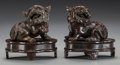 Asian:Chinese, A PAIR OF CHINESE PATINATED BRONZE FOO DOGS ON STANDS. 4 incheshigh (10.2 cm) (including stand). Property of the Estate o...(Total: 2 Items)