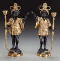 Decorative Arts, Continental:Other , A PAIR OF CONTINENTAL BRONZE AND GILT BRONZE BLACKAMOORCANDLESTICKS, late 19th century. 15-1/2 inches high (39.4 cm).Pro... (Total: 2 Items)
