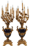 Decorative Arts, Continental:Lamps & Lighting, A PAIR OF LOUIS XV-STYLE PORCELAIN AND GILT BRONZE SEVEN-LIGHTLAMPS, early 20th century. 47 inches high (119.4 cm). F... (Total:2 Items)