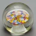 Art Glass:Other , AN ITALIAN MILLEFIORI GLASS BASKET OF FLOWERS PAPERWEIGHT, 20thcentury. 3-3/4 inches high x 3-1/2 inches diameter (9.5 x 8....