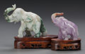Asian:Chinese, TWO CHINESE CARVED HARD STONE ELEPHANTS ON CARVED WOOD STANDS, 20thcentury. 5 x 6 x 2 inches (12.7 x 15.2 x 5.1 cm) (larger... (Total:3 Items)