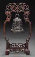 Asian:Chinese, A CHINESE ARCHAIC-STYLE BRONZE BELL AND CARVED MAHOGANY STAND, 20thcentury. 17-3/4 inches high (45.1 cm). Property of the...