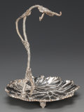 Silver Holloware, British, A VICTORIAN SILVER-PLATED GRAPE STAND, circa 1880. Marks:E.W., (swan), & S. 13-1/4 inches high (33.7 cm).From a ...
