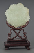 Carvings, A Chinese Carved Pale Green Jade Bi Disk on Carved Wood Stand. 4-1/2 inches high (11.4 cm). ...