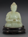 Asian:Chinese, A CHINESE CARVED PALE JADE BUDDHA ON A MAHOGANY AND SILVER INLAYSTAND, 20th century. 7 inches high (17.8 cm). ... (Total: 2 Items)
