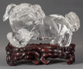 Asian:Chinese, A CHINESE ROCK CRYSTAL FOO DOG AND ROSEWOOD STAND, Qing dynasty.8-3/4 inches high x 11 inches wide (22.2 x 27.9 cm). ... (Total: 2Items)