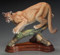 A CONNOISSEUR POLYCHROME PORCELAIN PUMA ON A CARVED WOOD BASE, 20th century Marks