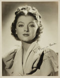 Autographs:Celebrities, Myrna Loy Black and White Inscribed Photograph. Ca. 1939. Measures10 x 13 inches. Small closed tear, repaired with adhesive...