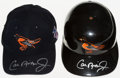 Baseball Collectibles:Hats, Cal Ripken Jr. Signed Baltimore Orioles Cap and Helmet....