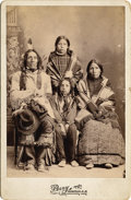 Photography:Cabinet Photos, PERRY CABINET OF KIOWA-CROW INDIAN FAMILY. Circa 1890s. Mother,father, son, and daughter pose stoically in this studio cabi...(Total: 1 Item)