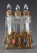 Decorative Arts, Continental:Other , A BOHEMIAN JEWELED AND GILT METAL PERFUME BRACKET WITH THREECUT-GLASS STOPPED BOTTLES, circa 1920. 4-1/4 inches high (10.8 ...(Total: 3 Items)