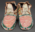 American Indian Art:Beadwork and Quillwork, A PAIR OF SIOUX BEADED AND QUILLED HIDE MOCCASINS. c. 1900...(Total: 2 Items)