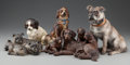 Paintings, FIVE CONTINENTAL TERRACOTTA AND CARVED WALNUT DOGS, circa 1900. 10 inches high (25.4 cm) (highest). FROM THE ESTATE OF RIC... (Total: 5 Items)