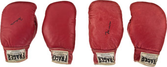 "Featured item image of 1965 Muhammad Ali & Sonny Liston Fight Worn Gloves-Both Pairs from the Famous ""Phantom Punch"" Bout...."