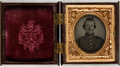 """Miscellaneous:Ephemera, Civil War Soldier's 1/16th Plate Tintype. Measuring 1"""" x 1.25""""(sight), this man is seen from the chest up in uniform in thi..."""