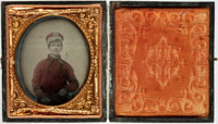 """Civil War Soldier's 1/6th Plate Ruby Ambrotype. This young man is seen in an oval portrait, measuring 2"""" x 2.5""""..."""