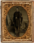 "Miscellaneous:Ephemera, 1/4 Plate Tintype of a Union Soldier. This full length, ovalportrait, 2.5"" x 3.5"" (sight), shows a Union sergeant with his ..."