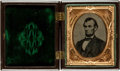 "Miscellaneous:Ephemera, Abraham Lincoln Tintype. The president is seen in a chest up, ovalportrait, measuring 1.25"" x 1.75"" (sight), turned slightl..."