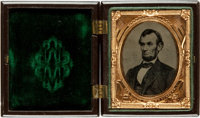 """Abraham Lincoln Tintype. The president is seen in a chest up, oval portrait, measuring 1.25"""" x 1.75"""" (sight)..."""