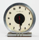 GILBERT ROHDE (American, 1894-1944) Clock, 1933, Herman Miller Chrome plated clock 6-1/4 x 2-3/4 inches (15.9 x 7.0 c
