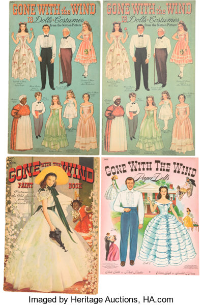 a group of vintage paper dolls and coloring books related to lot