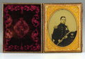 Military & Patriotic:Civil War, Early War Confederate Virginia Militia Officer Cased 1/2 Plate Ambrotype. This gentleman's secession cockade and dark blue f...