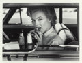 Photographs, PHILIPPE HALSMAN (American, 1906-1979). Marilyn at the Drive-In, 1952. Gelatin silver, printed 1981. 10 x 13 inches (25....