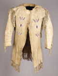 American Indian Art:War Shirts/Garments, A CROW MAN'S BEADED AND FRINGED HIDE COAT. c. 1890. ...