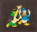Animation Art:Production Cel, The Three Caballeros Donald Duck and Jose Carioca ProductionCel and Courvoisier Background Setup (Walt Disney, 1945)....