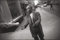 GARRY WINOGRAND (American, 1928-1984) New York City (Beggar), 1968-69 Gelatin silver, printed later<