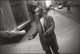 GARRY WINOGRAND (American, 1928-1984) New York City (Beggar), 1968-69 Gelatin silver, printed later 8-7/8 x 13-1/4 in