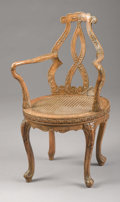 Furniture, An Italian Walnut Caned Armchair. . Unknown maker, Italian. Late 19th/early 20th century. Walnut. Unmarked. ...