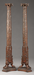 Decorative Arts, Continental, A Pair of Italian Carved Walnut Columns. Unknown maker, Italian.Late 18th/early 19th century. Walnut. Unmarked. 72 inches...(Total: 2 Items)