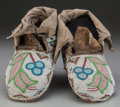 American Indian Art:Beadwork and Quillwork, A PAIR OF PLAINS CREE BEADED CLOTH AND HIDE MOCCASINS... (Total: 2Items)